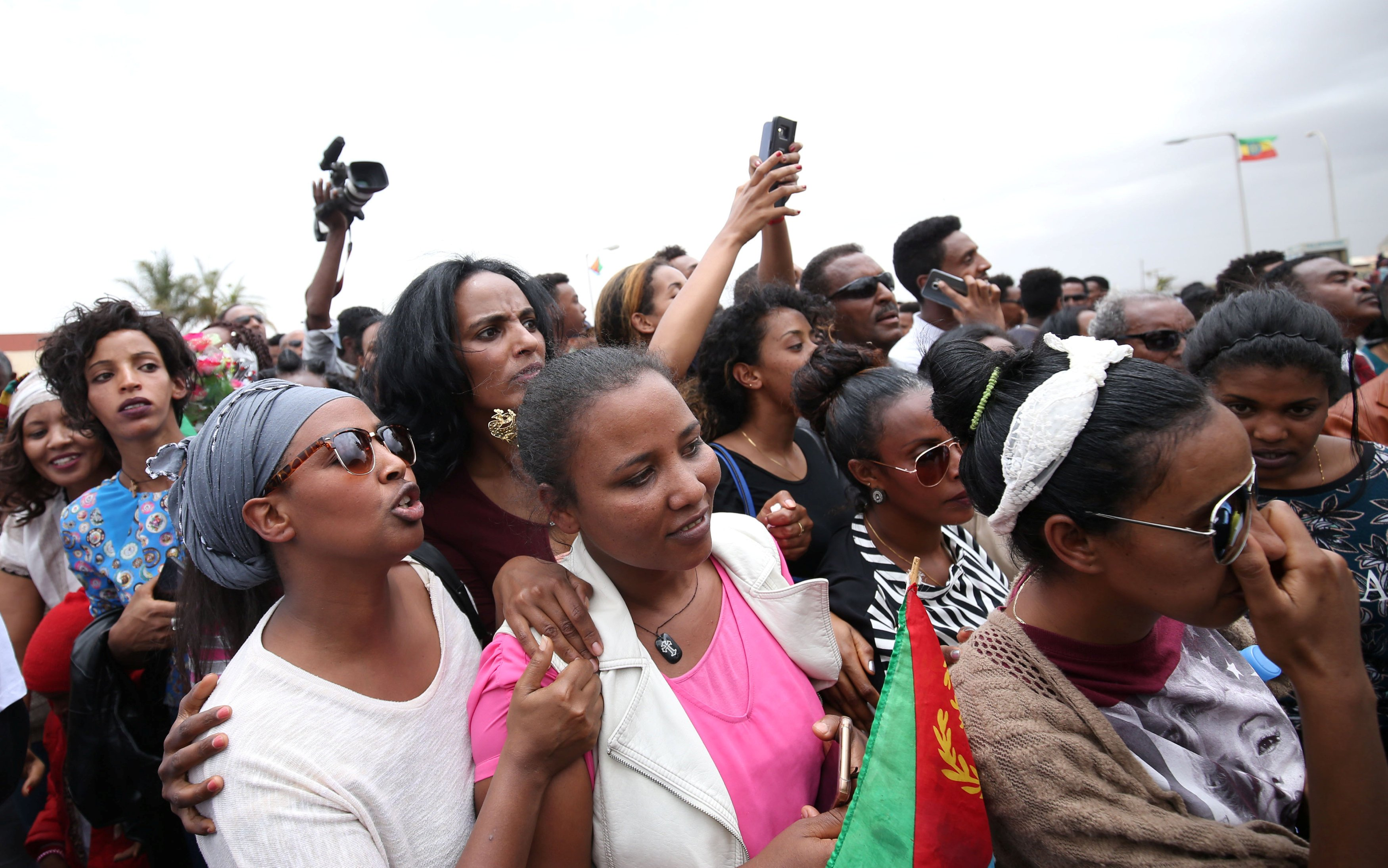 Eritreans wait to welcome their families at Asmara International Airport aboard the Ethiopian Airlines ET314 flight in Asmara, Eritrea July 18, 2018.