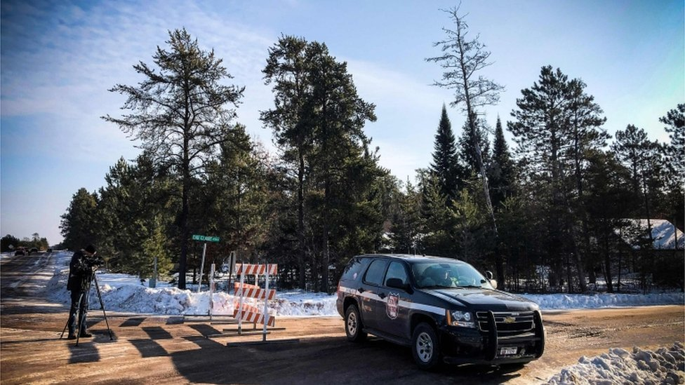 A police car blocks the road where teenager Jayme Closs was found on January 11, 2019 in Gordon, Wisconsin