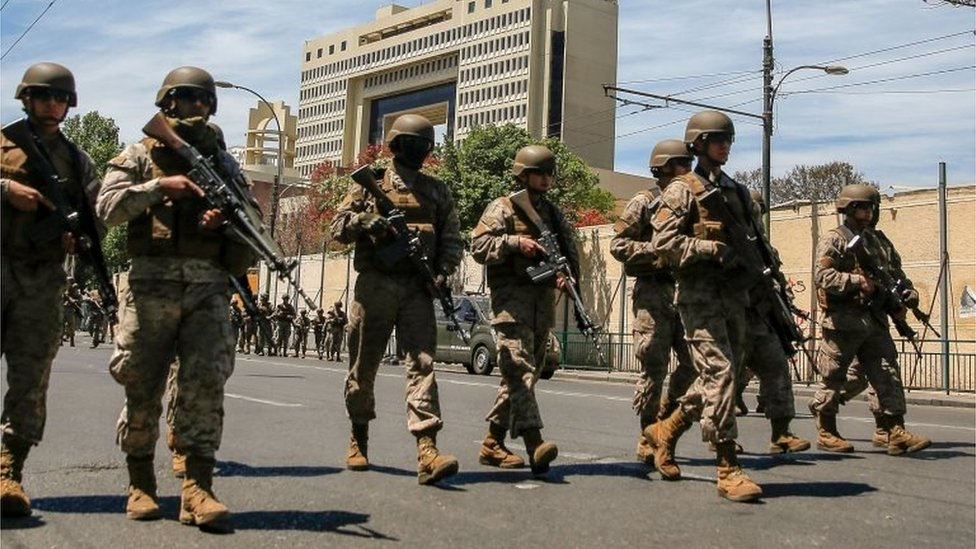 Soldiers take position outside the National Congress building in Valparaiso Chile, on October 22, 2019,