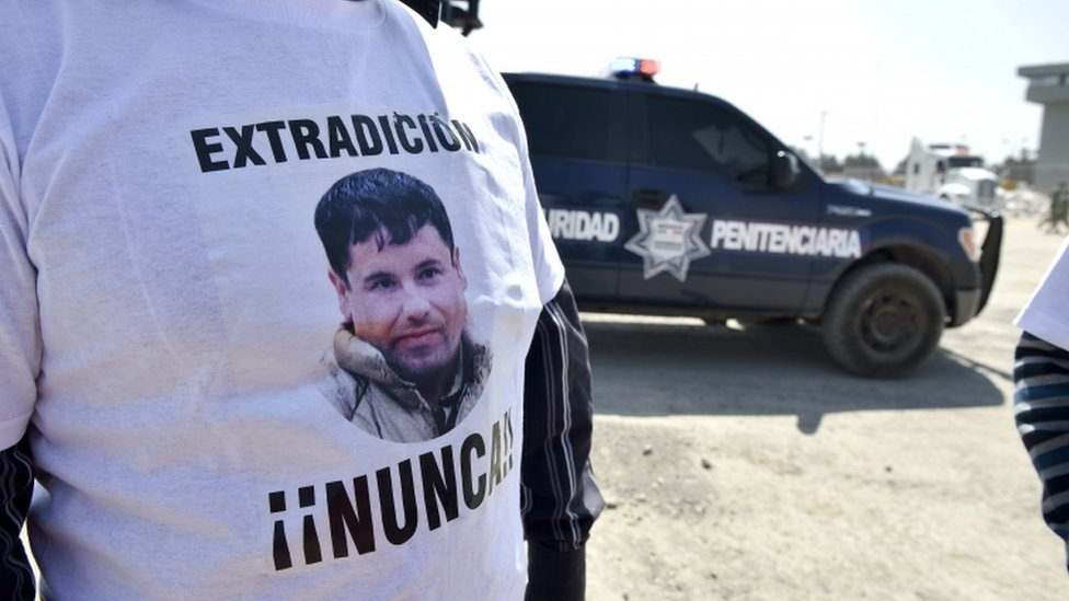 "An assistant to Jose Luis Gonzalez Meza (not framed), who alleges to be lawyer of imprisoned Mexican drug lord Joaquin ""El Chapo"" Guzman, wears a t-shirt that reads ""Extradition - Never!!"" against the the extradition of El Chapo to the US in front of El Altiplano prison on February 24, 2016 in Almoloya de Juarez, Mexico. AFP"