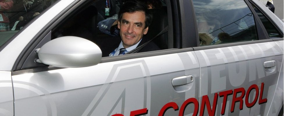 French Prime Minister Francois Fillon drives the Audi RS4 race control car, 16 June 2007 in Le Mans, before the start of Le Mans 24-hour endurance race