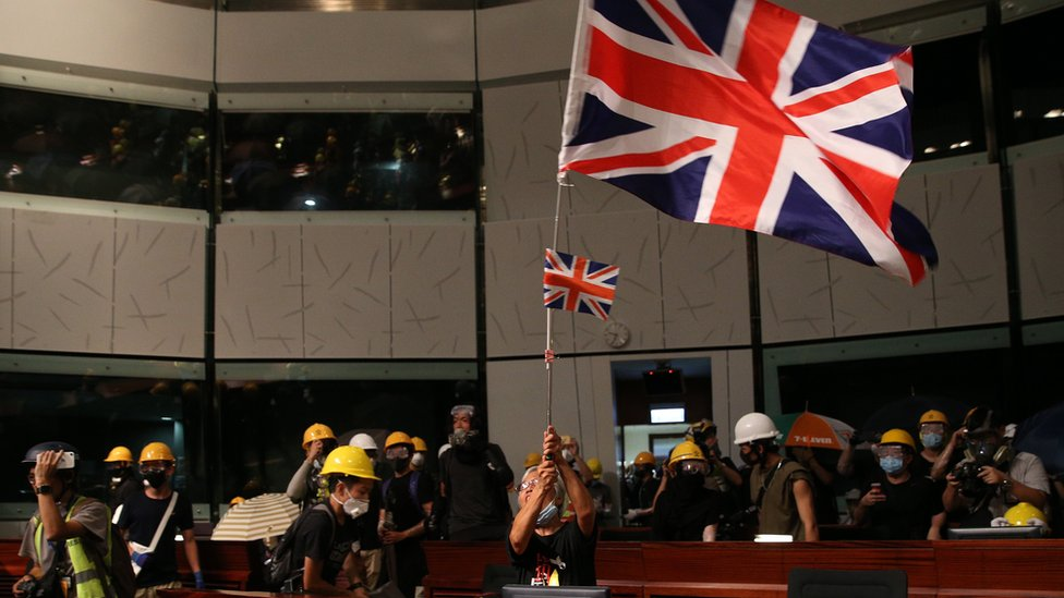 A British flag is seen inside the council building