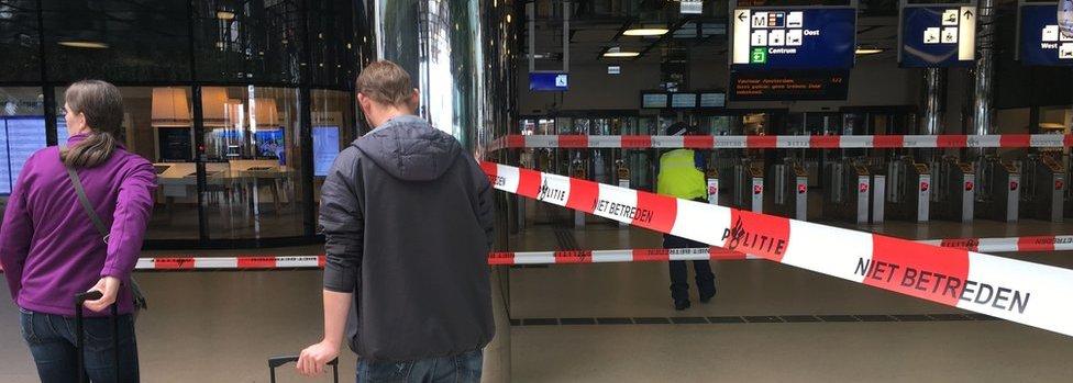 Passengers wait behind cordon on 31 August