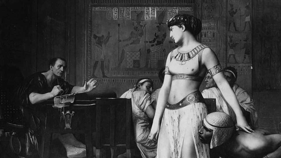 An illustration of Cleopatra and Julius Caesar