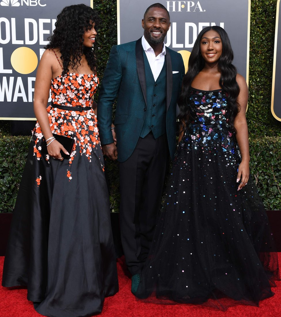 Golden Globe ambassador Isan Elba (R), actor Idris Elba and his fiance Sabrina Dhowre