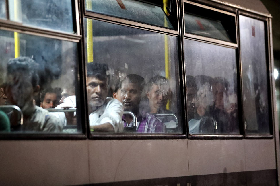 Migrants, rescued at sea by the Italian coastguard, are driven away on police buses after disembarking at the Armed Forces of Malta maritime base in Floriana, Malta. 17 September 2019