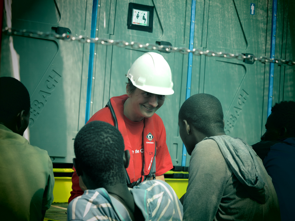 Volunteer on board talks to migrants