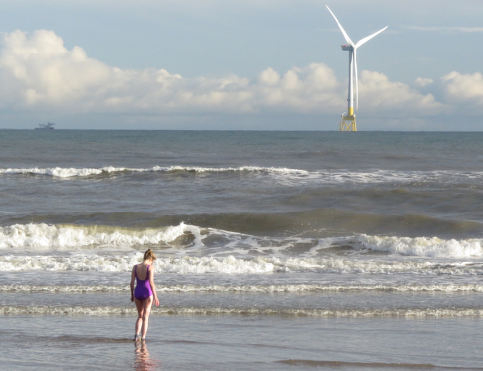 """""""My partner Nathalie Cortada about to take a dip at Balmedie beach,"""" says Alan Brown. """"She's wearing a swimming suit borrowed from my 82-year-old mum."""""""