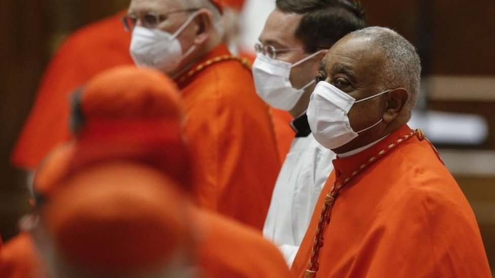 Wilton Gregory wearing a face mask as he is appointed a cardinal