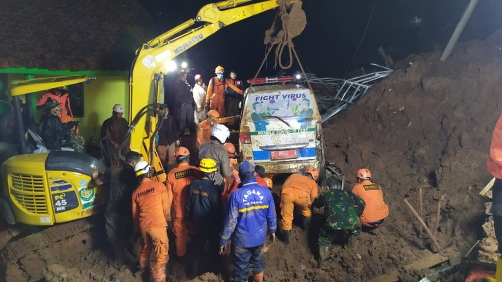 An ambulance is lifted from the mud after it was buried in a landslide in Sumedang, West Java, Indonesia, 9 January 2021