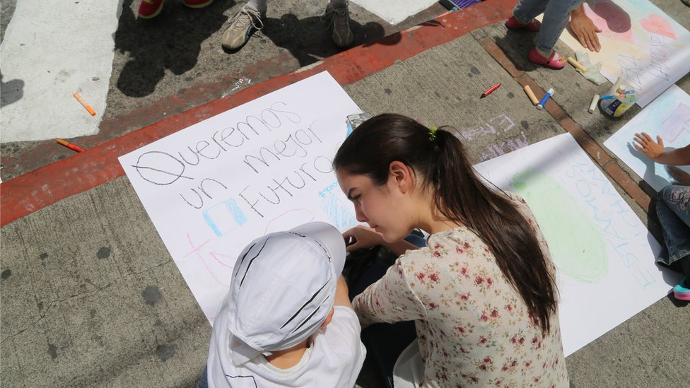 Children write 'We want a better future' in protest in Guatemala City - September 2015