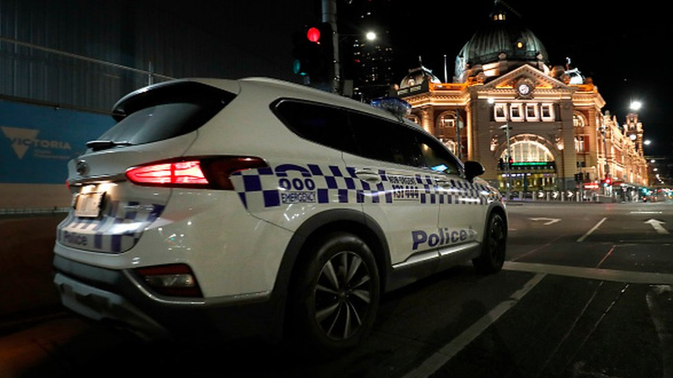 A Victorian Police car patrols the streets in Melbourne, Australia