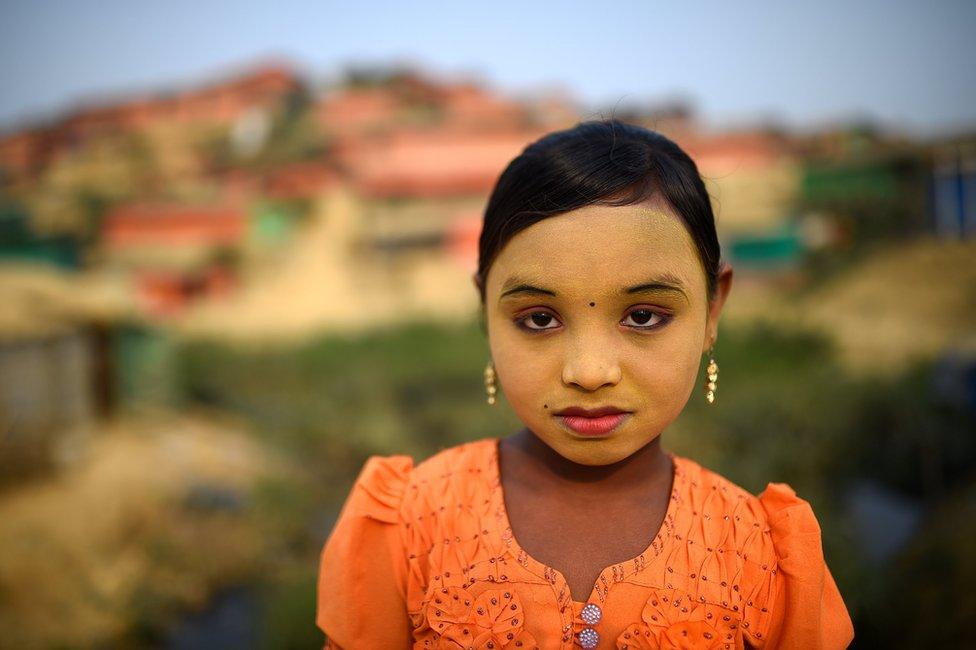 Rohingya refugee Zannat Ara, aged 9, poses for a photograph as she wears thanaka paste at Kutupalong camp in Cox's Bazaar, Bangladesh