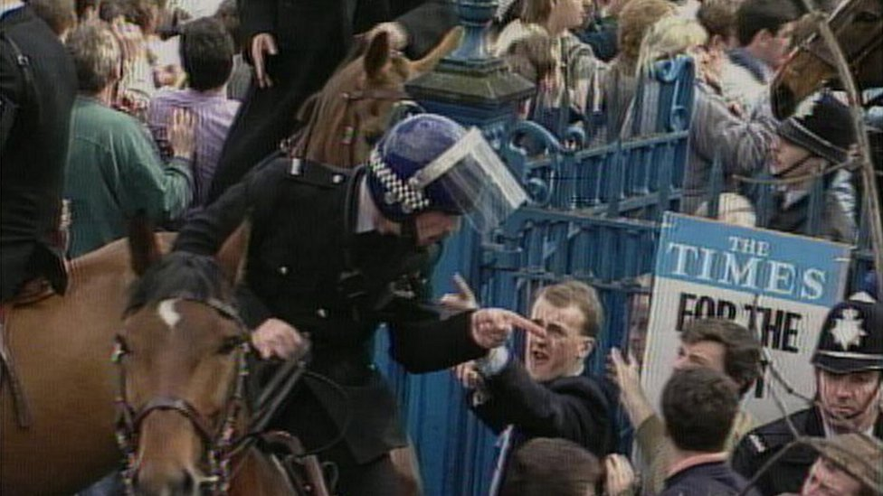 Fans argue with mounted police office outside Hillsborough