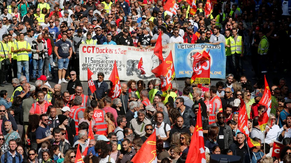 Demonstrators, holding CGT labour union flags, attend a national strike and protest against the governments labour reforms in Marseille on 12 September