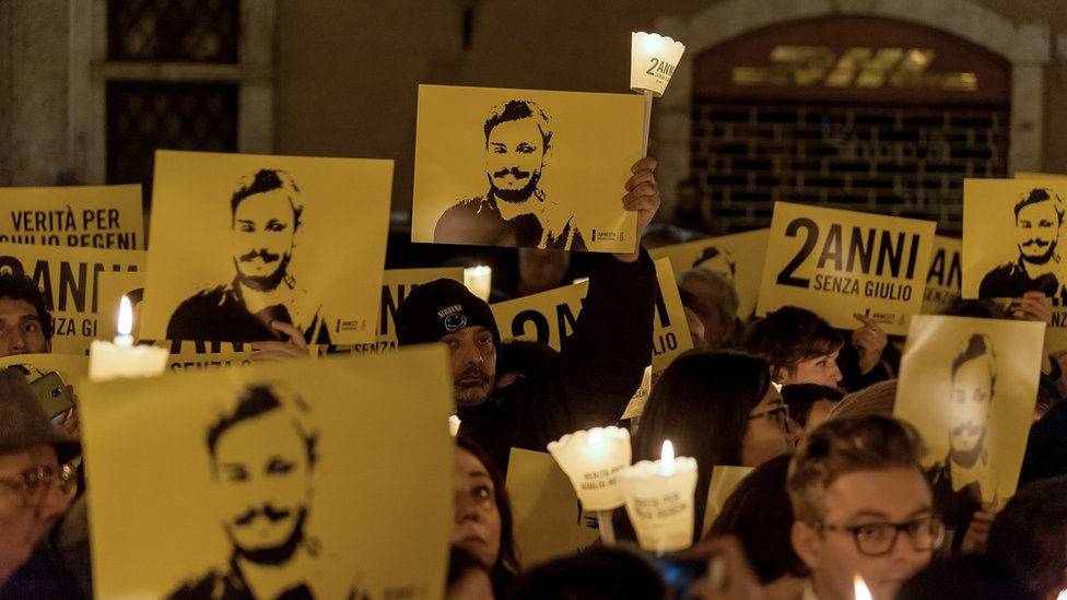 People take part in a torchlight procession organized by Amnesty International to commemorate the second anniversary of the death of Giulio Regeni on January 25, 2018 in Rome, Italy