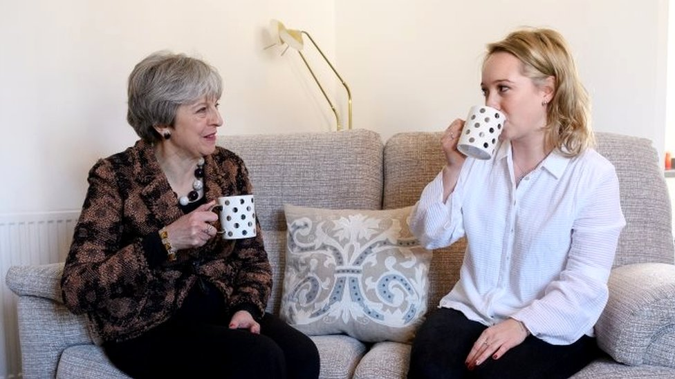 Theresa May visits first-time buyer Laura Paine