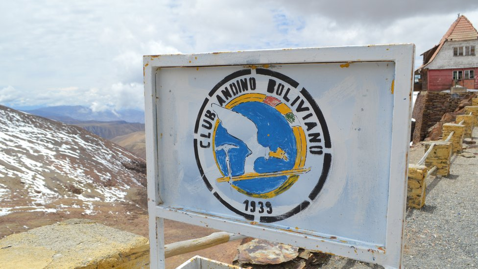 A rusty sign reads: Club Andino Boliviano skiing club