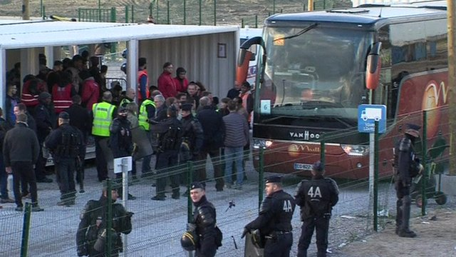 Migrants board a coach