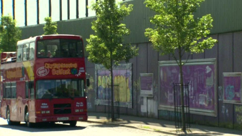 Tourist bus at peace wall