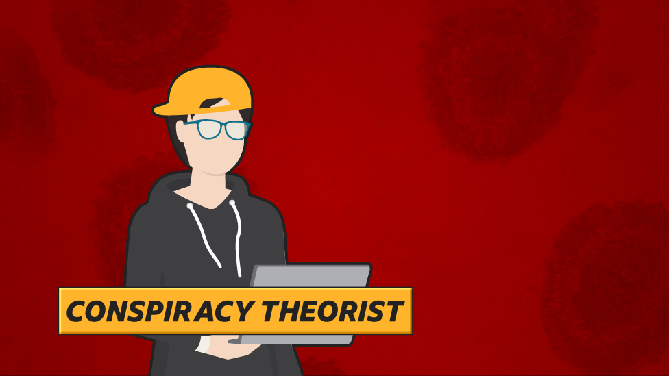 """Conspiracy theorist"": Man in glasses and hoodie sitting at laptop"