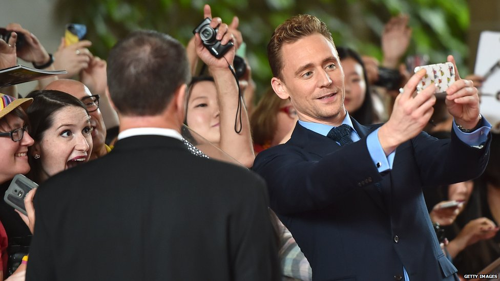 Tom Hiddleston takes a selfie photo with an excited fan at the recent Toronto International Film Festival