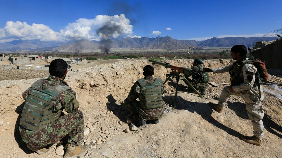 Afghan security forces take position during a gun battle between Taliban and Afghan security forces in Laghman province, Afghanistan