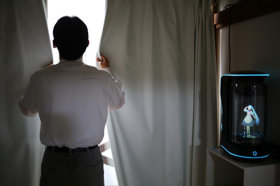 Akihiko pulls the curtains