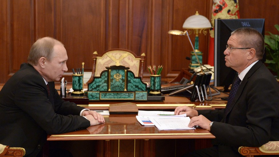 File pic: Russia's President Vladimir Putin (L) meets Economic Development Minister Alexei Ulyukayev in the Kremlin in Moscow, on July 7, 2014.