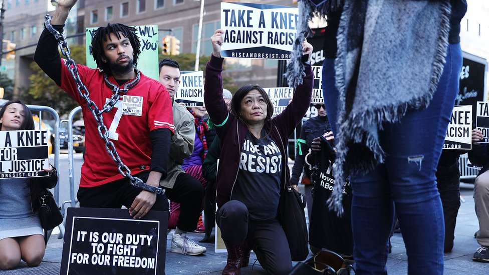 Protestors hold a demo outside an NFL meeting in New York, 2017