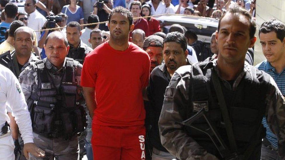 Bruno, being taken into police custody in July 2010