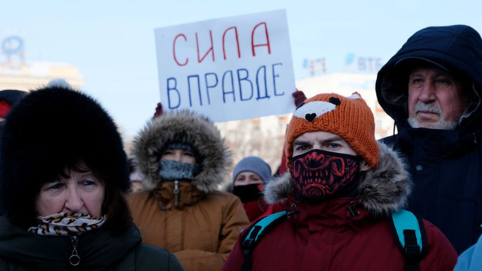 "A participant holds a poster reading ""Strength is in the Truth"" during an unauthorized rally Khabarovsk"