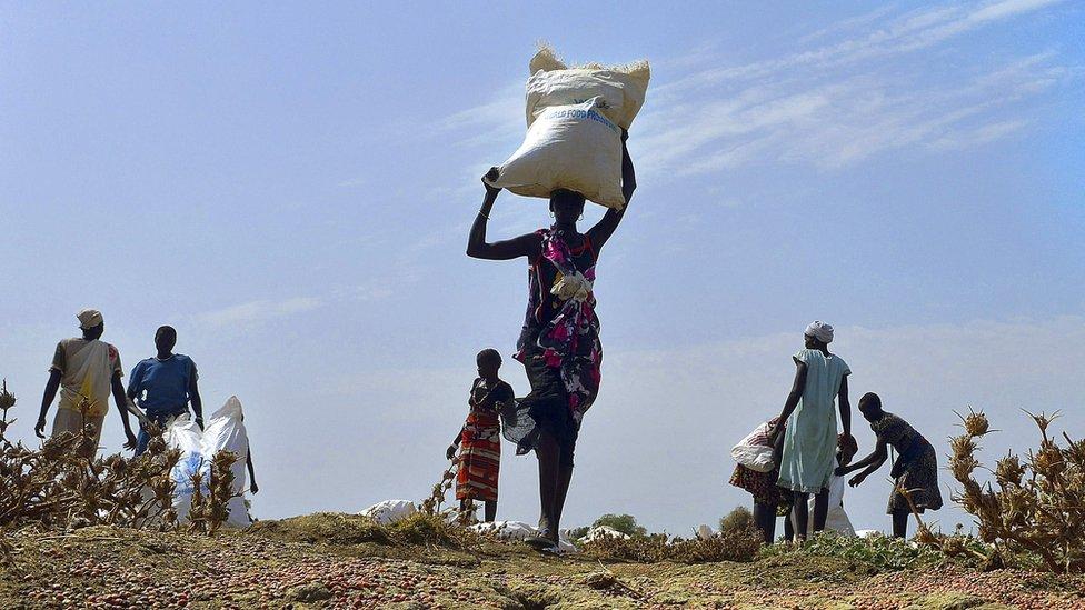 woman carries food