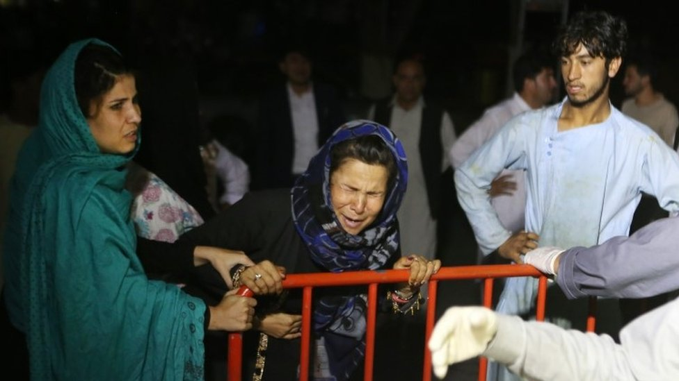 Relatives outside a hospital in Kabul last August