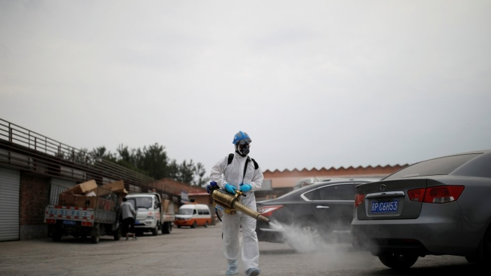 Employee disinfecting a Chinese street.