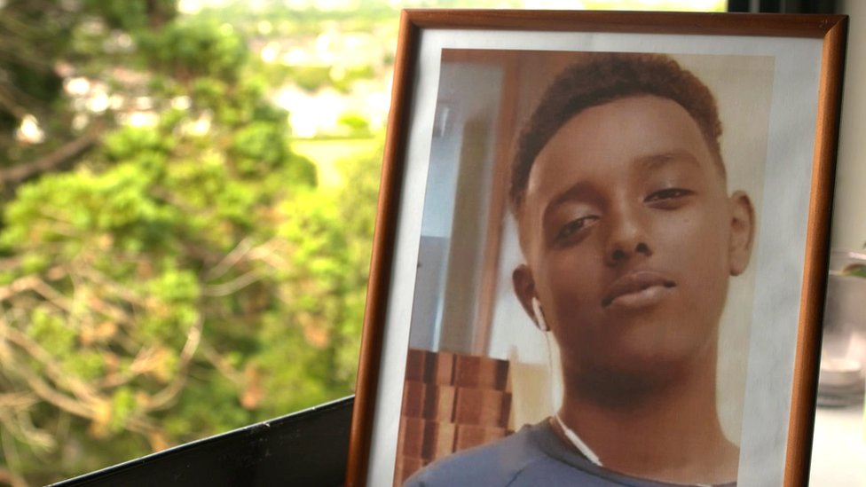 A picture in a frame of teenager Fahad Mohamed Nur who died after being stabbed in Cardiff