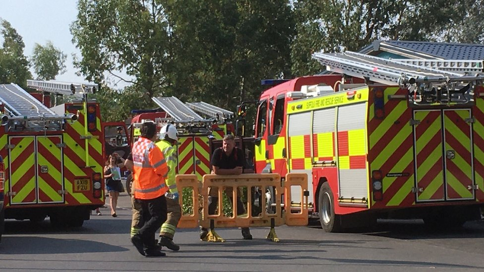 Fire crews outside a holiday park in Suffolk after a suspected chemical leak.