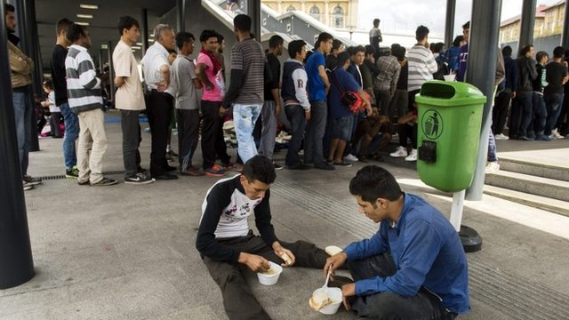 Migrants line up for a food distribution in Keleti railway station in Budapest