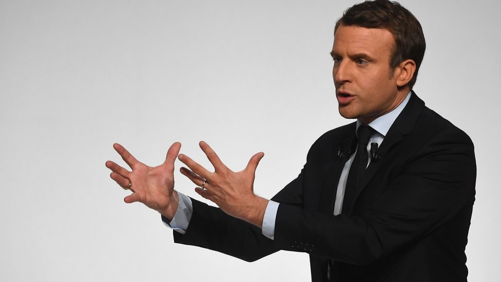 French presidential election candidate for the En Marche ! movement Emmanuel Macron gestures as he speaks to supporters at the Angerlarde hall in Chatellerault, western France on April 28, 2017.