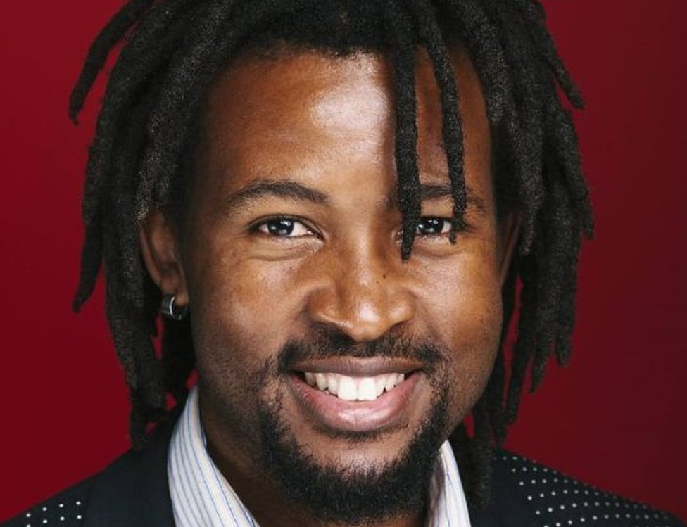 A headshot of Melusi Simelane