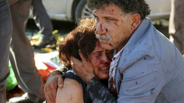 An injured man hugs an injured woman