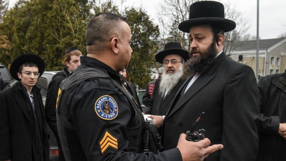 Men outside rabbi's house