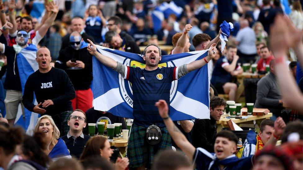Fans celebrating in Glasgow
