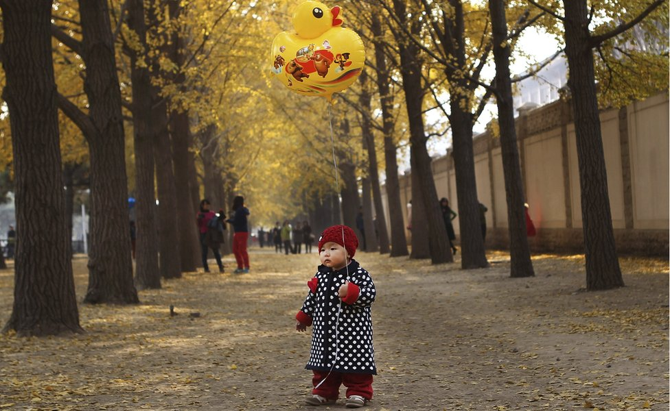 A child holds a balloon in Beijing (Nov 2013)