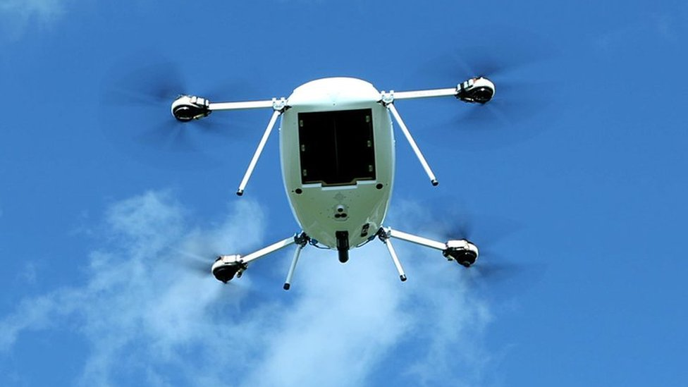 A Manna aero drone takes flight against a blue sky with scattered clouds