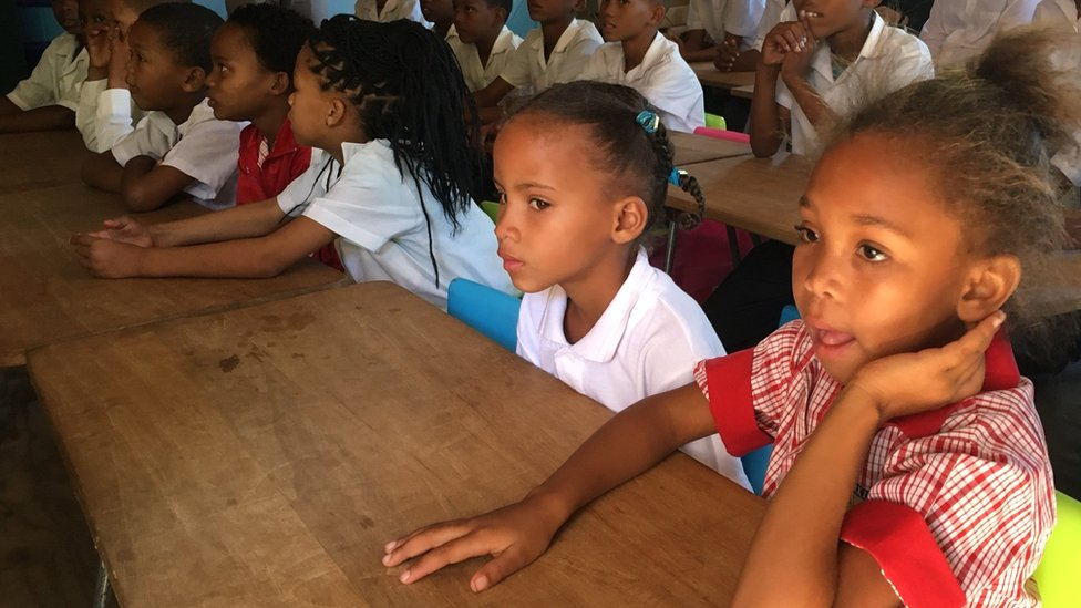 A group of children learning N  u in a class in Upington