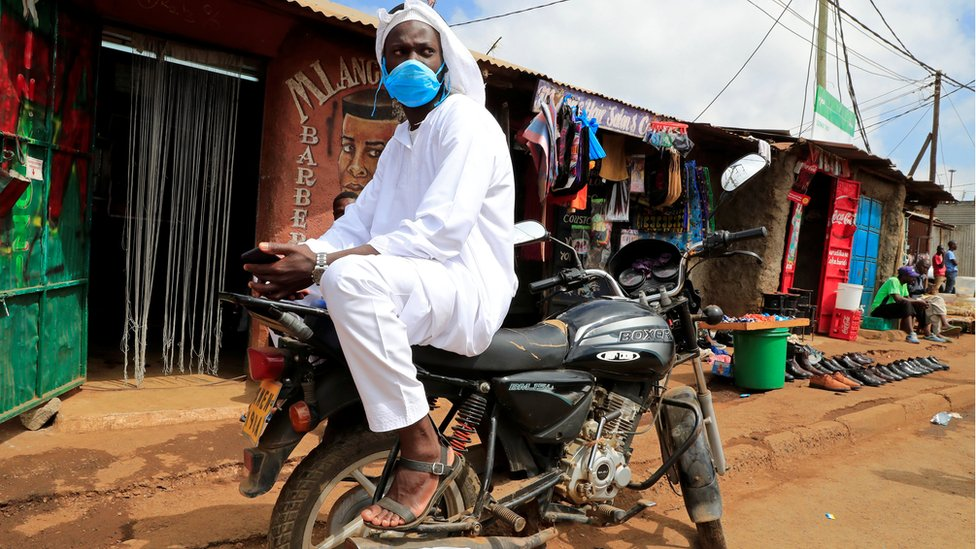 Ramadhan Issa, a Muslim motorbike taxi rider, waits for customers after performing the Eid al-Fitr prayers, marking the end of the holy fasting month of Ramadan, amid concerns about the spread of the coronavirus disease (COVID-19), in Nairobi, Kenya, May 24, 2020
