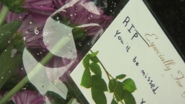 Close up of memorial note at scene of teenager's death in Bexleyheath