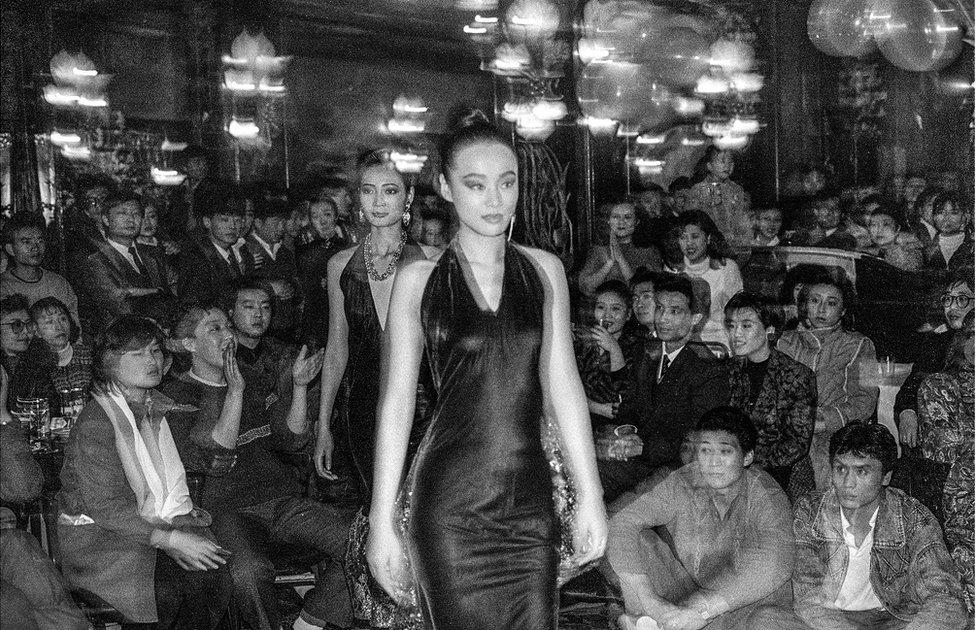 Models walk along a catwalk