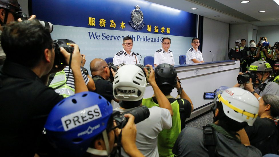 """Press photographers wear helmets and protective masks to denounce police treatment during yesterday""""s protest against a proposed extradition bill with China in Hong Kong, China, June 13, 2019"""